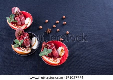 smoked pork in plates with spices, meal - stock photo