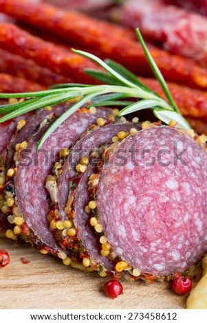 smoked salami, sausages, proschiutto and cheese - stock photo