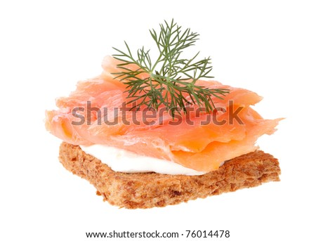 Smoked salmon and soft cheese on a piece of bread - stock photo