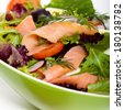 Smoked salmon salad with red onion, egg, carrots and radishes. Selective focus. - stock photo