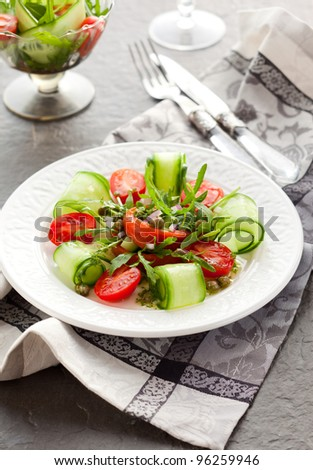Smoked salmon salad with rocket,cucumber,tomato and capers