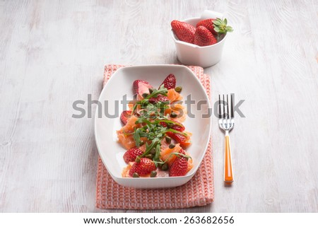 smoked salmon salad with strawberries arugula and capers - stock photo