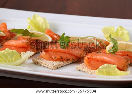 Smoked salmon snacks - stock photo