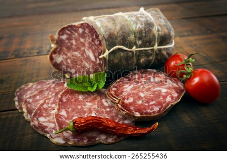 Smoked sausage with mint and peppercorns - stock photo