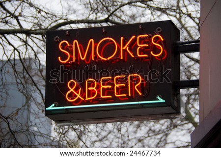 Smokes and beer neon sign in Seattle, Washington - stock photo