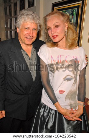 """Smokey Miles and Julie Newmar  EXCLUSIVE at Julie Newmar ~A Life in Motion"""" at the David  W. Streets Gallery, Beverly Hills, CA. 11-08-09 - stock photo"""