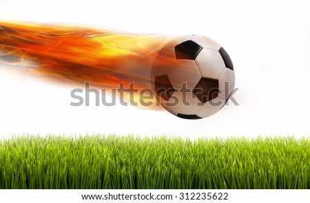 Smokin soccer ball on fire over green field. - stock photo