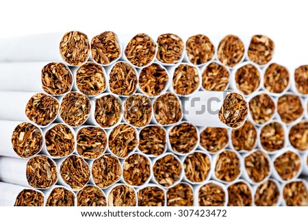 smoking - a strong harm to health, isolation stack cigarettes on a white background closeup