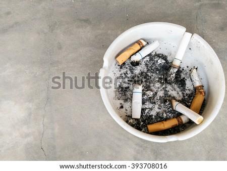 smoking ashtray on white(Soft focus) - stock photo