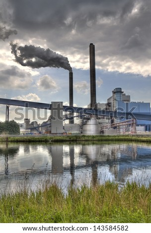 Smoking chimney at industrial plant in Amsterdam, Holland