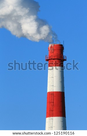 smoking chimneys of the factory - stock photo