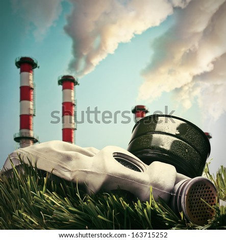 Smoking chimneys polluting the environment of the planet earth. Toned image. - stock photo