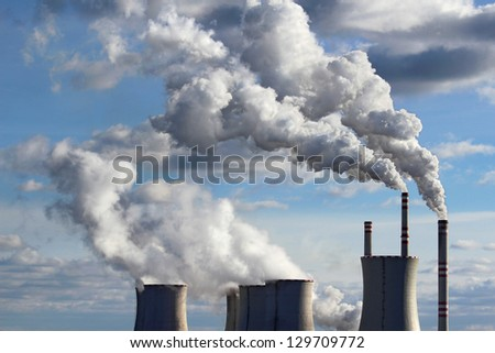 smoking cooling towers of coal power plant - stock photo