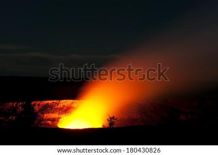 Smoking Crater of Halemaumau Kilauea Volcano in Hawaii Volcanoes National Park on Big Island at night - stock photo