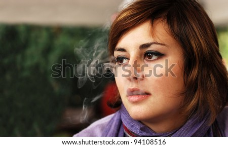 smoking girl - stock photo