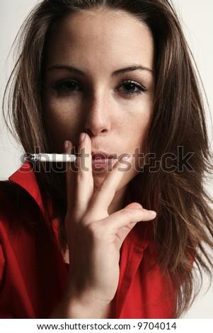 Smoking girl - stock photo