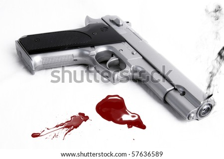 Smoking gun and blood splatter - stock photo
