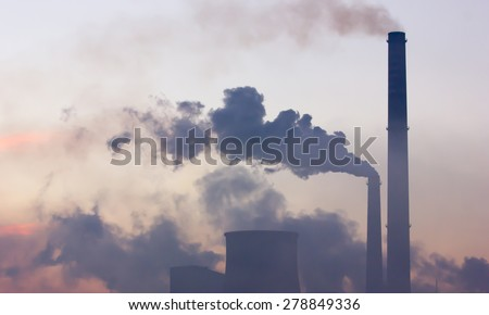 Smoking industrial chimneys at dawn. Concept for environmental protection