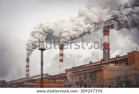 Smoking industrial pipes.. - stock photo
