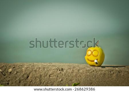 smoking kills, social advertisment with yellow apple - stock photo