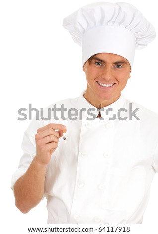 smoking male cook in white uniform and hat - stock photo
