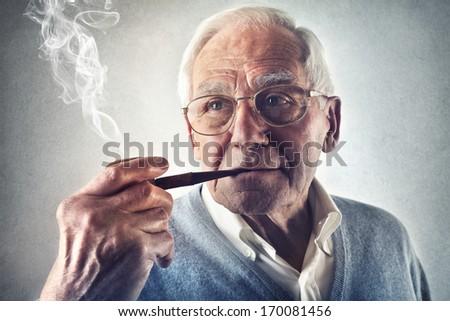 Smoking Oldie - stock photo