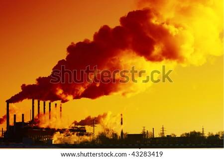 Smoking plant and blue sky - stock photo