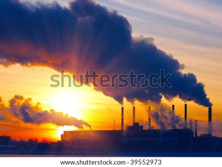Smoking plant and sunset - stock photo