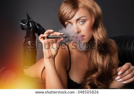 smoking vape pen in a sexy way