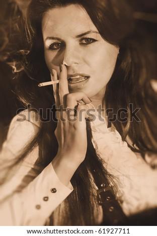 Smoking woman portrait. Retro style colors. - stock photo