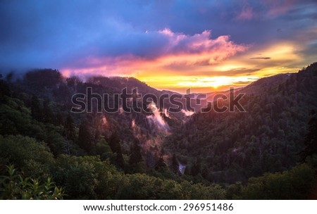 Smoky Mountain Sunset. The sunsets over the horizon of the Great Smoky Mountains National Park, as mist rises up from the valley. Gatlinburg, Tennessee. - stock photo