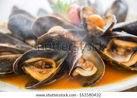 Smoky spicy mussels - stock photo