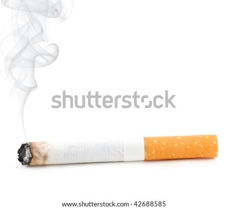 smoldering cigarette with smoke isolated on white - stock photo