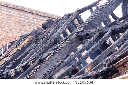 Smoldering remains of a burnt out building - stock photo