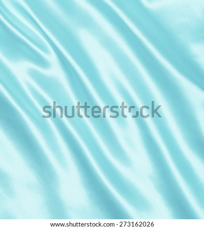 Smooth elegant blue silk or satin can use as background - stock photo
