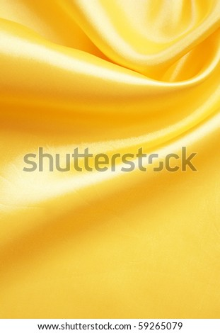 Smooth elegant golden silk can use as background - stock photo