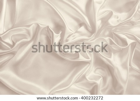 Smooth elegant golden silk or satin can use as background. In Sepia toned. Retro style - stock photo