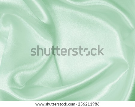 Smooth elegant green silk can use as wedding background - stock photo