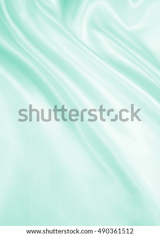 Smooth elegant green silk or satin texture can use as background