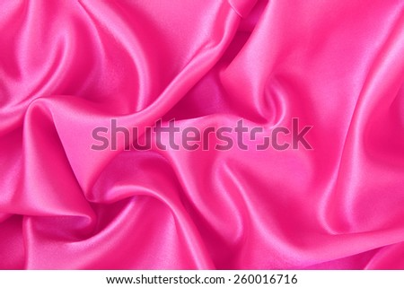 Smooth elegant pink silk or satin can use as background  - stock photo