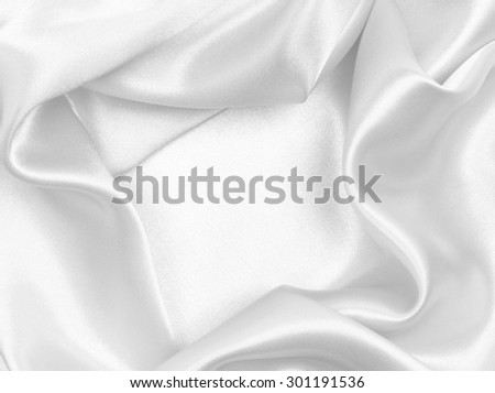 Smooth elegant white silk or satin texture can use as wedding background