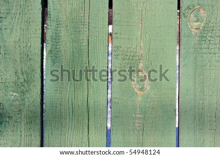 Smooth fence pine boards painted green - stock photo