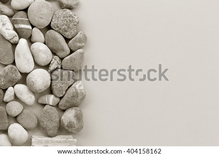 smooth river stone on gray background. zen like concepts. Free space for text. copy space. black and white image - stock photo