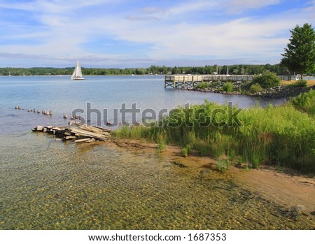 Smooth sailing on Lake Michigan's clear water - Suttons Bay, Michigan - stock photo