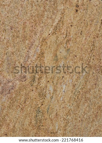 smooth solid striped yellow-brown large granite slab with green patches  - stock photo