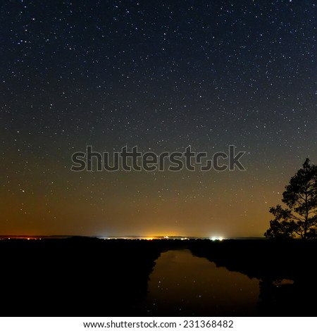 Smooth surface of the river on a background the starry sky  - stock photo