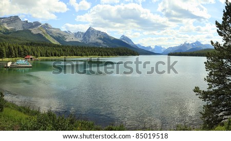 Smooth water of mountain lakes (Maligne lake. Jasper National Park, Alberta, Canada)