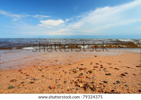 Smoothed stones along the beautiful shoreline of Lake Superior in the Upper Peninsula of Michigan - stock photo