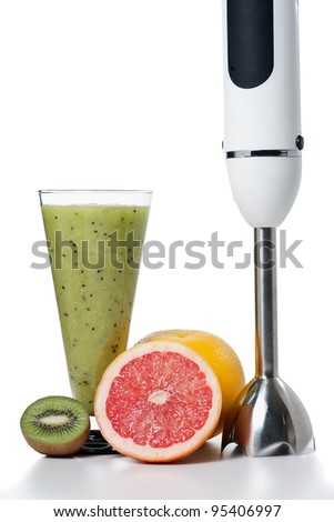 Smoothie and fresh fruits with small electric blender - stock photo