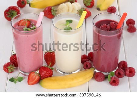 Smoothie fruit juice with fruits like strawberries, raspberries and banana in glass